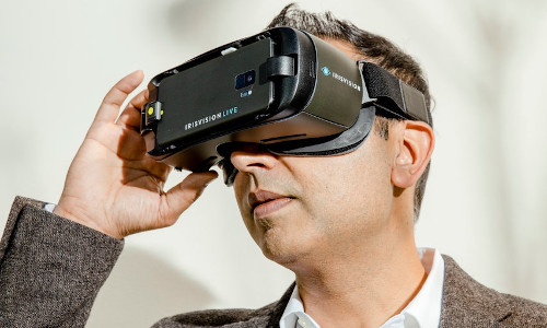 Ammad Khan, chief executive of IrisVision, with the company's device to help those with low vision see better.